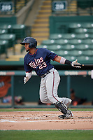 GCL Twins first baseman Yeison Perez (23) follows through on a swing during the first game of a doubleheader against the GCL Orioles on August 1, 2018 at CenturyLink Sports Complex Fields in Fort Myers, Florida.  GCL Twins defeated GCL Orioles 7-6 in the completion of a suspended game originally started on July 31st, 2018.  (Mike Janes/Four Seam Images)