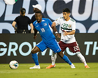 CHARLOTTE, NC - JUNE 23: Samuel Camille #18 looks to pass the ball away from Uriel Antuna #22 during a game between Mexico and Martinique at Bank of America Stadium on June 23, 2019 in Charlotte, North Carolina.