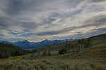 Idaho, South central, Stanley. The Sawtooth Mountains under wispy summer clouds as viewed from the Boulder Mountains up Fourth of July Creek.