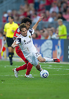 28 August 2010: Real Salt Lake midfielder Ned Grabavoy #20 and Toronto FC midfielder Julian de Guzman #6 in action during a game between Real Salt Lake and Toronto FC at BMO Field in Toronto..The game ended in a 0-0 draw..