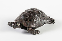BNPS.co.uk (01202) 558833.<br /> Pic: NT/JamesDobson/BNPS<br /> <br /> One of the four returned tortoises at Kingston Lacy, Dorset.<br /> <br /> Slow and steady wins the race...<br /> <br /> A set of bronze tortoises stolen from a country mansion have finally been returned... 29 years later.<br /> <br /> The bronze sculptures based on the wealthy 19th century owner's pet were stolen from Kingston Lacy in Dorset in 1992 and reported to the police but never found until a savvy historian spotted one up for auction recently.<br /> <br /> Following the trail, the National Trust traced the tortoise to an antiques dealer, who had acquired the set from a scrap metal dealer, completely unaware of their history.<br /> <br /> The four missing sculptures have finally been returned to Kingston Lacy and gone on display.