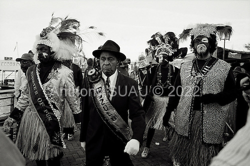 New Orleans, Louisiana.USA.February 27, 2006..The King and Queen of the Zulu Socisl aid and Pleasure Club arrive to Mardi Gras by boat and are greeted by New Orleans Mayor C. Ray Nagin...Zulu members march through the French Quarter.
