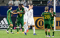 CARSON, CA - OCTOBER 07: Yimmi Chara #23 of the Portland Timbers  scores a goal and celebrates with Felipe Mora #9 and Diego Valeri #8 and his Portland Timbers teammates during a game between Portland Timbers and Los Angeles Galaxy at Dignity Heath Sports Park on October 07, 2020 in Carson, California.