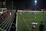 Ashton United 6 Ramsbottom United 0, 12/01/2016. Hurst Cross stadium, Northern Premier League. An early corner for the home team during the first-half of the fixture between Ashton United (in red) and Ramsbottom United in the Northern Premier League premier division. The match was played at Ashton's Hurst Cross stadium, the club's ground. The club was originally founded in 1878 as Hurst F.C. and by 1880 the club were playing at Hurst Cross, their current ground which makes their home one of the oldest football grounds in the world. Ashton won the match 6-0, watched by a crowd of 178. Photo by Colin McPherson.