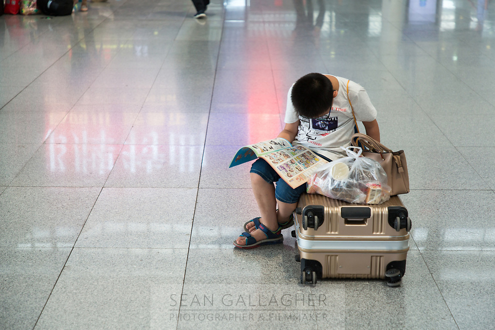 A passenger in Xining railway station, one of the main stops on the train journey that runs into Tibet and onto Lhasa.