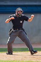 Home plate umpire Ben Leake calls a batter out on strikes during an Appalachian League game between the Bluefield Orioles and the Princeton Rays at Hunnicutt Field July 4, 2010, in Princeton, West Virginia.  Photo by Brian Westerholt / Four Seam Images