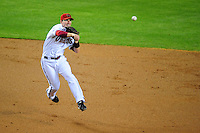 Apr. 21, 2008; Phoenix, AZ, USA; Arizona Diamondbacks shortstop Stephen Drew makes a leaping throw to first base against the San Francisco Giants at Chase Field. Mandatory Credit: Mark J. Rebilas-
