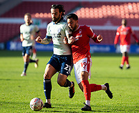 9th January 2021; City Ground, Nottinghamshire, Midlands, England; English FA Cup Football, Nottingham Forest versus Cardiff City; Miguel Angel Guerrero of Nottingham Forest comes in to shoulder charge Marlon Pack of Cardiff City as they run down a loose ball
