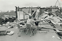 1979 FILE PHOTO - ARCHIVES -<br /> <br /> Oxford Centre residents Wanda Lively (left) and Darlene Wilson take a break from rummaging in the rubble for their possessions<br /> Bezant, Graham<br /> Picture,  August 1979,<br /> <br /> 1979,<br /> <br /> PHOTO : Graham Bezant - Toronto Star Archives - AQP