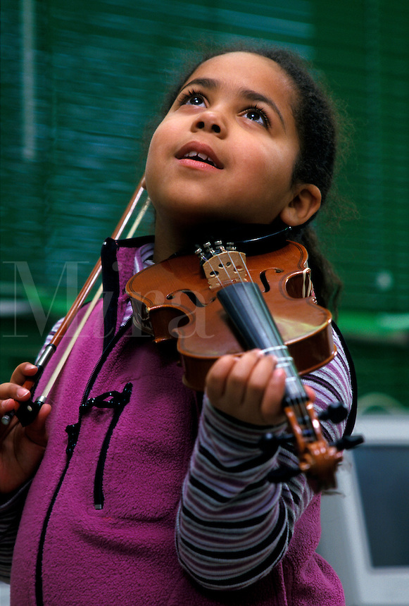 Girl playing the violin. music, child, children, education, school, expression, inpiration, inspired, joy, happy,