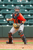 Frederick Keys catcher Allan de San Miguel (11) fakes a throw to first base against the Winston-Salem Dash at BB&T Ballpark on July 21, 2013 in Winston-Salem, North Carolina.  The Dash defeated the Keys 3-2.  (Brian Westerholt/Four Seam Images)