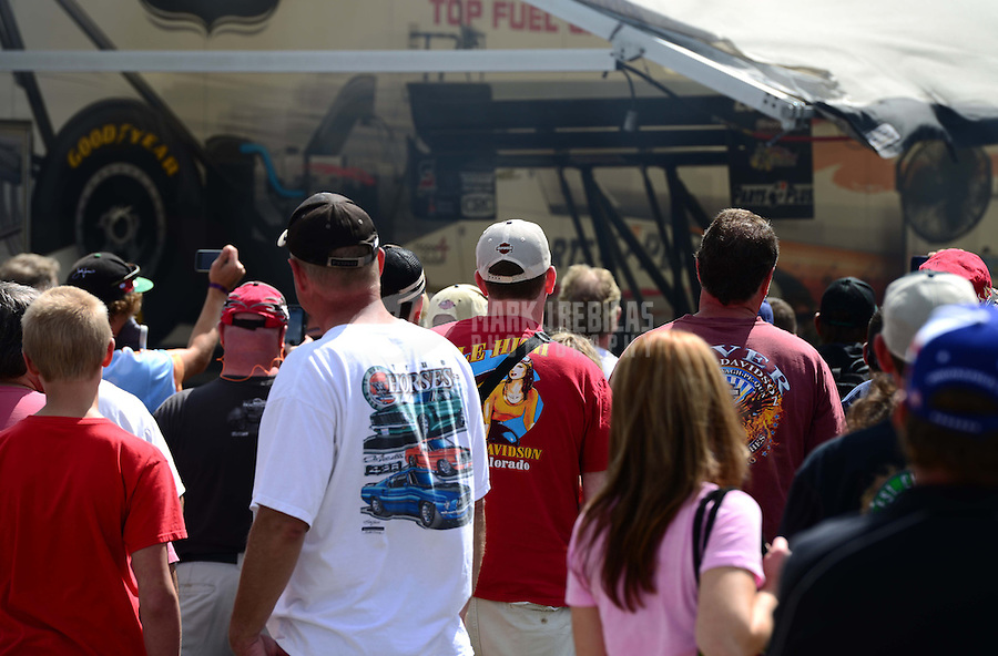 Sept 8, 2012; Clermont, IN, USA: NHRA nitro fans gather at the pit of top fuel dragster driver Clay Millican during qualifying for the US Nationals at Lucas Oil Raceway. Mandatory Credit: Mark J. Rebilas-
