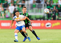 AUSTIN, TX - JUNE 19: Matt Besler #5 of Austin FC  keeps Cristian Espinoza #10 of the SJ Earthquakes from getting to a loose ball during a game between San Jose Earthquakes and Austin FC at Q2 Stadium on June 19, 2021 in Austin, Texas.