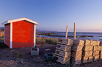 Newfoundland, NF, Canada, Red shed and lobster traps at Green Point on the Gulf of St. Lawrence. Gros Morne National Park.