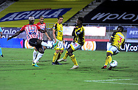 BARRANQUILLA - COLOMBIA, 08-11-2020: German Mera de Atletico Junior, anota gol a Juan Serano (Fuera de Cuadro) de Alianza Petrolera, durante partido entre Atletico Junior y Alianza Petrolera, de la fecha 18 por la Liga BetPlay DIMAYOR 2020 jugado en el estadio Romelio Martinez de la ciudad de Barranquilla. / German Mera of Atletico Junior scored a goal to Juan Serano (Out of Pic) of Alianza Petrolera, during a match between Atletico Junior and Alianza Petrolera of the 18th date for the BetPlay DIMAYOR Leguaje 2020 played at the Romelio Martinez Stadium in Barranquilla city. / Photo: VizzorImage / Jesus Rico / Cont.
