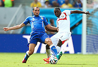 Giorgio Chiellini of Italy and Joel Campbell of Costa Rica in action