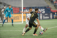 FOXBOROUGH, MA - AUGUST 3: Brandon Bye #15 of New England Revolution tackles Diego Rossi #9 of Los Angeles FC during a game between Los Angeles FC and New England Revolution at Gillette Stadium on August 3, 2019 in Foxborough, Massachusetts.