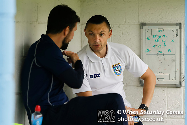 Ryan Farrell Yorkshire Head Coach, and Micky Long Yorkshire Team Coach discuss tactics at half time. Yorkshire v Parishes of Jersey, CONIFA Heritage Cup, Ingfield Stadium, Ossett. Yorkshire's first competitive game. The Yorkshire International Football Association was formed in 2017 and accepted by CONIFA in 2018. Their first competative fixture saw them host Parishes of Jersey in the Heritage Cup at Ingfield stadium in Ossett. Yorkshire won 1-0 with a 93 minute goal in front of 521 people. Photo by Paul Thompson