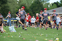 Young fans pick up candy after it was dropped from a helicopter after a Batavia Muckdogs against the Mahoning Valley Scrappers on August 24, 2014 at Dwyer Stadium in Batavia, New York.  Mahoning Valley defeated Batavia 7-6.  (Mike Janes/Four Seam Images)