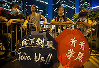 Pro-democracy protesters are seen outside the Hong Kong government headquarters, on the second day of the mass civil disobedience campaign Occupy Hong Kong, Admiralty, Hong Kong, China, 30 September 2014. The movement is also being dubbed the 'umbrella revolution' after the versatile umbrellas used to shield protesters from rain, sun - and police pepper spray.