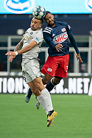 FOXBOROUGH, MA - APRIL 17: Hernan Gonzalez #19 of Richmond Kickers and Christian Malfa #38 of New England Revolution II compete for a high ball during a game between Richmond Kickers and Revolution II at Gillette Stadium on April 17, 2021 in Foxborough, Massachusetts.