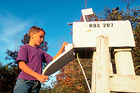 Boy at rural mailbox.