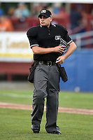 Umpire Anthony Perez during a game between the State College Spikes and Batavia Muckdogs on July 3, 2014 at Dwyer Stadium in Batavia, New York.  State College defeated Batavia 7-1.  (Mike Janes/Four Seam Images)