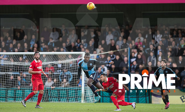 Aaron Pierre of Wycombe Wanderers heads clear of Calaum Jahraldo-Martin of Leyton Orient during the Sky Bet League 2 match between Wycombe Wanderers and Leyton Orient at Adams Park, High Wycombe, England on 23 January 2016. Photo by Andy Rowland / PRiME Media Images.