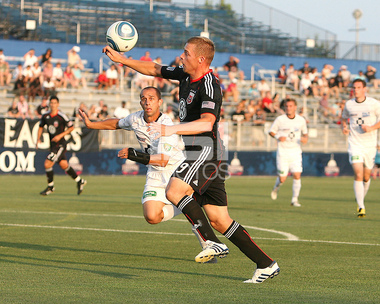 Danny Allsopp #9 of D.C. United pushes a high ball past Anthony Calvano #23 of the Harrisburg City Islanders during a US Open Cup match at the Maryland Soccerplex on July 21 2010, in Boyds, Maryland. United won 2-0.