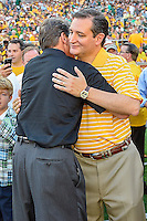 Governor of Texas Rick Perry embraces U.S. Senator Ted Cruz before NCAA Football game between SMU and Baylor at McLean Stadium, Sunday, August 31, 2014 in Waco, Tex. (Mo Khursheed/TFV Media via AP Images)