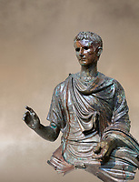 Roman bronze statue fragment of emperor Augustus, Circa 12-10 BC,  found in the Agean sea of  the Island of Euboea, Athens National Archaeological Museum. cat no X 23322.<br /> <br /> The emperor Augustus is depicted in mature age mounting a horse. He wears a tunica with verivle purple stripes (clavus purpurea) fringed with a meander pattern. Icongraphic features of bthe Prima Porta and Actuim type of statue are incorporated in this brnze statue. The right hand is raised in a gesture of offical greeting and the left hand held the horses reigns. A ring on the finger gears has engraved the symbol of Pontifles Maximus assumed by Augustus in 12 BC