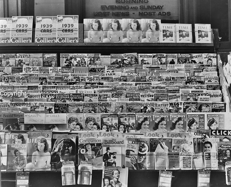 Newsstand in Omaha, Nebraska. November 1938.<br /> <br /> Photo by John Vachon.
