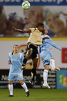 Formiga (31) of FC Gold Pride and Kelly Parker (7) of Sky Blue FC go up for a header. Sky Blue FC and FC Gold Pride played to a 1-1 tie during a Women's Professional Soccer match at TD Bank Ballpark in Bridgewater, NJ, on April 11, 2009.