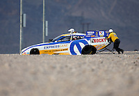 Mar 29, 2014; Las Vegas, NV, USA; The Safety Safari pushes NHRA funny car driver Matt Hagan out of harms way at the end of the track during qualifying for the Summitracing.com Nationals at The Strip at Las Vegas Motor Speedway. Mandatory Credit: Mark J. Rebilas-