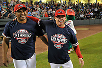 Greenville Drive players celebrate their 2017 South Atlantic League Championship following an 8-3 win over the Kannapolis Intimidators in Game 4 of the Championship Series on Friday, September 15, 2017, at Fluor Field at the West End in Greenville, South Carolina. Manager Darren Fenster, right, hugs hitting coach Wilton Veras. It was Greenville's first SAL Championship. Greenville won the series 3-1. (Tom Priddy/Four Seam Images)