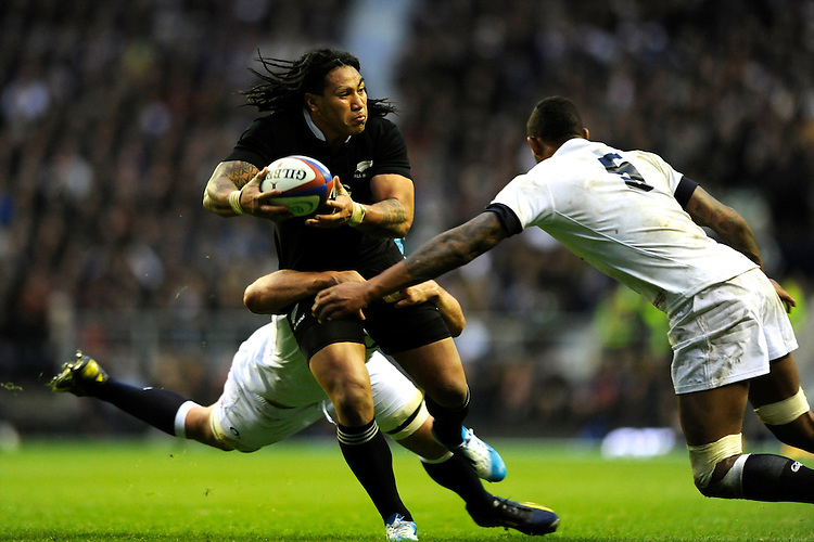 Ma'a Nonu of New Zealand is tackled by Ben Morgan (left) and Courtney Lawes of England during the QBE Autumn International match between England and New Zealand at Twickenham on Saturday 16th November 2013 (Photo by Rob Munro)
