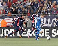 Philadelphia Union substitute forward Antoine Hoppenot (29) on the attack as New England Revolution midfielder Lee Nguyen (24) closes.In a Major League Soccer (MLS) match, the New England Revolution (blue/red) defeated Philadelphia Union (blue/white), 2-0, at Gillette Stadium on April 27, 2013.