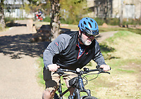 Brian Shamblin of Rogers rides with his son Carson Shamblin, 12, (not pictured) who is celebrating his birthday by breaking in a new bike, Sunday, November 15, 2020 along the Mama Bear trail in Bentonville. Check out nwaonline.com/201116Daily/ for today's photo gallery. <br /> (NWA Democrat-Gazette/Charlie Kaijo)