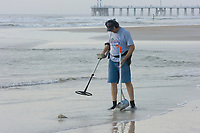 Treasure hunters with portable metal detectors comb Daytona Beach for a lucky find left behind by tourists.. Atlantic Ocean (do) (no MR)