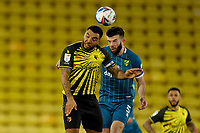 26th December 2020; Vicarage Road, Watford, Hertfordshire, England; English Football League Championship Football, Watford versus Norwich City; Grant Hanley of Norwich City wins a header against Troy Deeney of Watford