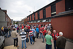 Crusaders 1 Fulham 3, 16/07/2011. Seaview Park, Europa League 2nd qualifying round first leg. Rival fans gathering in the street for a drink outside the social club at Seaview Park, Belfast before Northern Irish club Crusaders take on Fulham in a UEFA Europa League 2nd qualifying round, first leg match. The visitors from England won by 3 goals to 1 before a crowd of 3011. Photo by Colin McPherson.