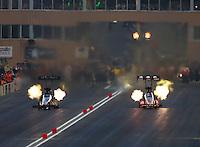 Jul. 18, 2014; Morrison, CO, USA; NHRA top fuel driver Doug Kalitta (right) races alongside Khalid Albalooshi during qualifying for the Mile High Nationals at Bandimere Speedway. Mandatory Credit: Mark J. Rebilas-