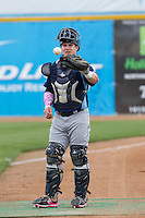 Corpus Christi Hooks catcher Jon Heineman (4) warms up before the Texas League baseball game against the San Antonio Missions on May 10, 2015 at Nelson Wolff Stadium in San Antonio, Texas. The Missions defeated the Hooks 6-5. (Andrew Woolley/Four Seam Images)