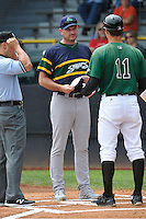 Beloit Snappers Manager Fran Riordan (27) along with umpire Brandon Mooney talk with Clinton LumberKings Manager Mitch Canham at home plate prior to the Midwest League game against the Clinton LumberKings at Ashford University Field on June 12, 2016 in Clinton, Iowa.  The LumberKings won 1-0.  (Dennis Hubbard/Four Seam Images)