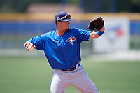 Toronto Blue Jays J.C. Cardenas (7) throws to first base during a minor league Spring Training game against the New York Yankees on March 30, 2017 at the Englebert Complex in Dunedin, Florida.  (Mike Janes/Four Seam Images)