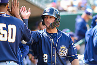 San Antonio Missions infielder Jake Hager (2) high-fives teammates in the dugout during a Pacific Coast League game against the Iowa Cubs on May 2, 2019 at Principal Park in Des Moines, Iowa. Iowa defeated San Antonio 8-6. (Brad Krause/Four Seam Images)