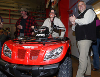 Laura Allaway is delighted to win the Northern Air Cargo 4-wheeler by drawing the lucky key that started it at the finishers banquet in Nome as Dave Karp of NAC claps on Sunday  March 22, 2015 during Iditarod 2015.  <br /> <br /> (C) Jeff Schultz/SchultzPhoto.com - ALL RIGHTS RESERVED<br />  DUPLICATION  PROHIBITED  WITHOUT  PERMISSION