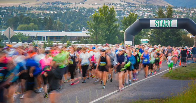 group of runners at the start line of the missoula montana marathon