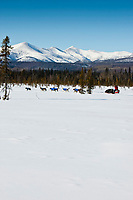 Gerald Sousa runs down a swamp two miles after leaving the the Kaltag checkpoint with the Nulato Hills in the background during the 2010 Iditarod