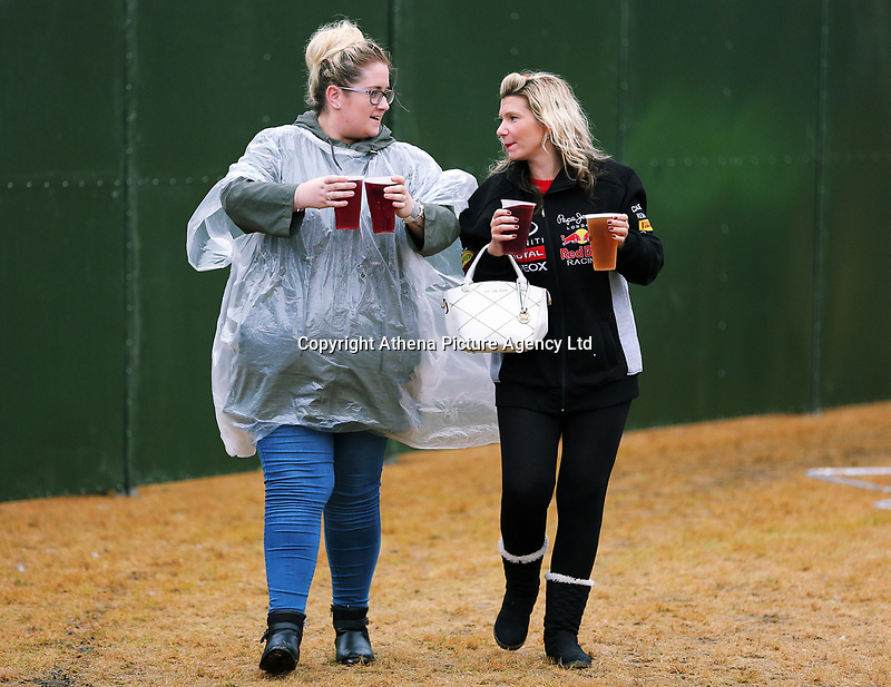 Two women with drinks<br />UB40 concert at Parc Y Scarlets, Llanelli, Wales, UK. Saturday 10 June 2017